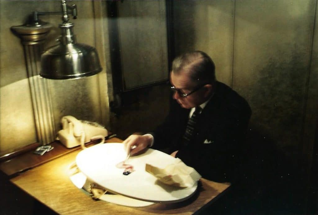 Caption: Milton Beattie creating a waving flag display. He created similar designs so often in his career, that from beginning to end, the display took 30 minutes to create.