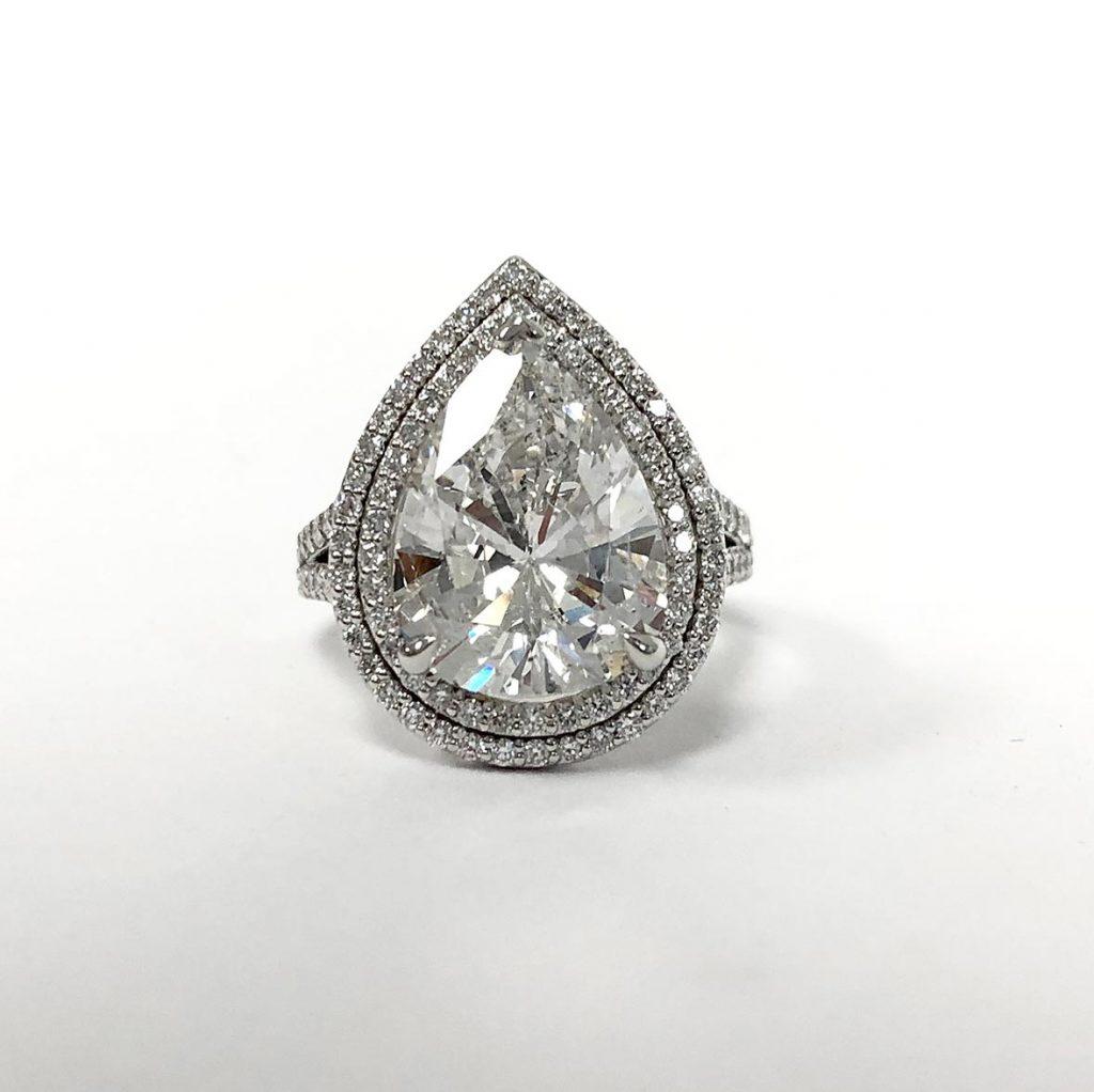 custom pear-shape diamond ring made with a recycled diamond